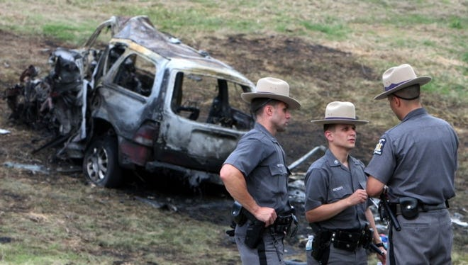 In this July 26, 2009, file photo, New York State troopers work at the scene of a fatal accident in which eight people were killed on the Taconic State Parkway in Hawthorne, N.Y. NBC will air an interview with the mother of three girls killed in the crash.