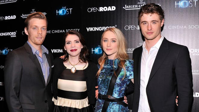 Stephenie Meyer poses with the stars of the film adaptation of her book 'The Host': Jake Abel, Saoirse Ronan and Max Irons.