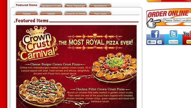 A Cheese Burger Crown Crust Pizza is topped with beef, tomatoes, lettuce, Pizza Hut's sauce, with a ring of grilled mini cheeseburgers on top of the crust. The Chicken Fillet Crown Crust Pizza has chicken fingers in place of the cheeseburgers.