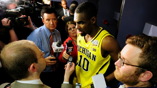 Michigan guard Tim Hardaway Jr. (10) talks to the media in the locker room after losing to Louisville in the championship game in the 2013 NCAA men's basketball tournament at the Georgia Dome. Hardaway Jr. announced Wednesday he plans to forgo his senior season to enter the NBA draft.