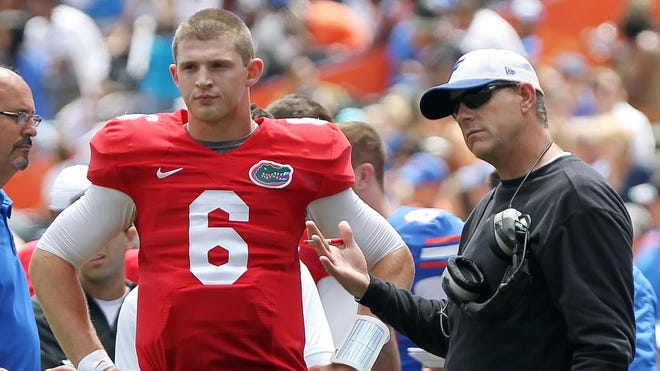 """Florida offensive coordinator Brent Pease talks with quarterback Jeff Driskel (6) during the spring practice at Ben Hill Griffin Stadium on April 6. Pease recently fancied himself as a coaching """"Maverick"""" in a Top Gun sendup to potential football recruits."""