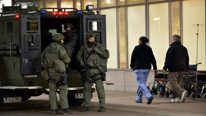 A SWAT team secures the main entrance to Brigham and Women's Hospital in Boston Tuesday. Many who were wounded when two explosions struck near the finish line of the Boston Marathon were brought to this hospital.