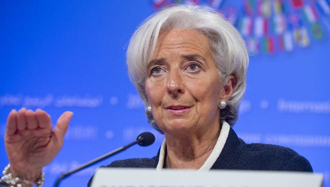 International Monetary Fund Managing Director Christine Lagarde briefs the press at IMF headquarters in Washington, D.C., April 18, 2013.