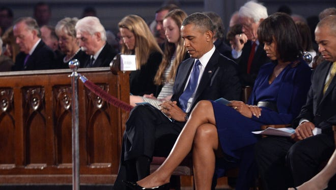 """President Obama and first lady Michelle Obama attend the """"Healing Our City: An Interfaith Service"""" at the Cathedral of the Holy Cross in Boston on Thursday."""