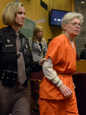 Sandra Layne, 75, is led out of court after being sentenced April 18 to at least 22 years in prison despite her plea to a judge to spare her from dying behind bars.