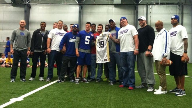 Giants players pose after visiting with 700 children from Sandy Hook and other local schools in Newtown, Conn. Thursday.