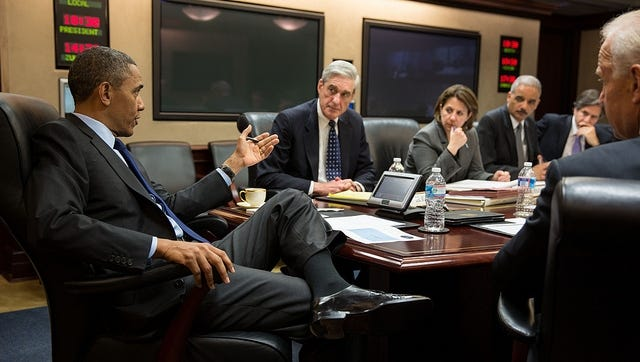 President Obama discusses developments in Boston with members of his national security team in the White House Situation Room on Friday.