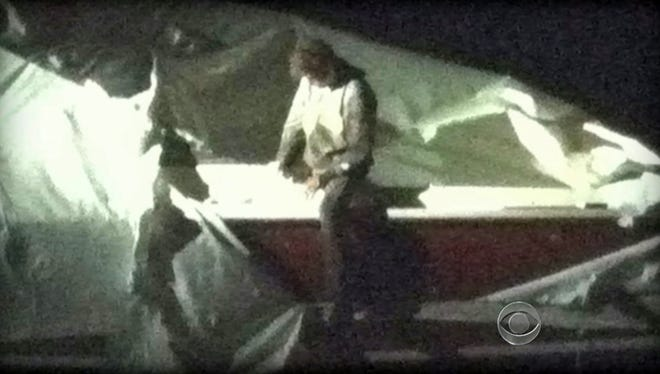 This image obtained Friday courtesy of CBS News shows Dzhokhar Tsarnaev, a suspect in the Boston Marathon bombing who was captured after he was found hiding in a boat in a Boston suburb.