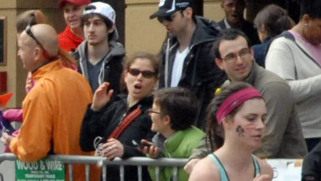 Police say this image shows Dzhokhar Tsarnaev, in the white hat, and Tamerlan Tsarnaev, in the black hat, at the Boston Marathon. This image was taken approximately 10-20 minutes before the blast that killed three and injured more than 260.