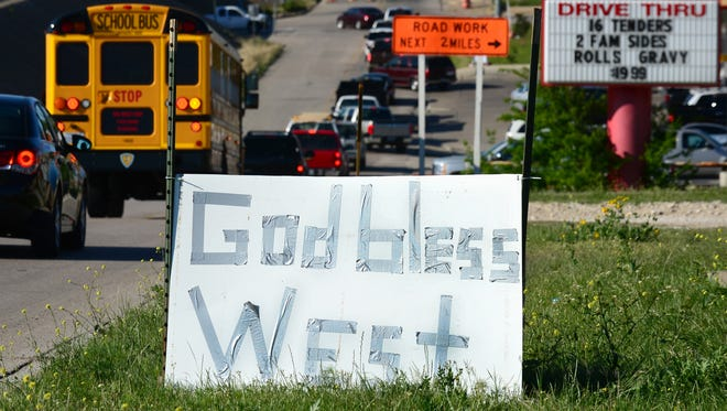 A makeshift sign is placed on the side of a road in West, Texas, on April 20, 2013, three days after the deadly fertilizer plant blast.