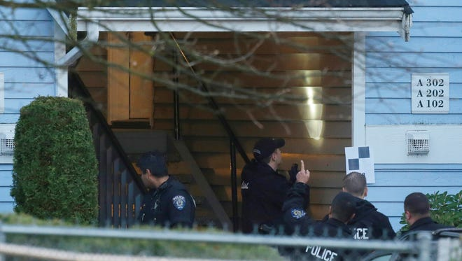Investigators Monday examined a stairwell at the Pinewood Village apartment complex in Federal Way, about 20 miles south of Seattle, where a gunman killed four people Sunday night before police shot him dead.