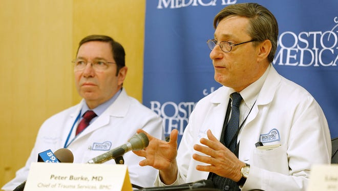 Dr. Peter Burke, chief of trauma services, and Joseph Blansfield, trauma program manager, speak during a press conference on April 18 at Boston Medical Center.