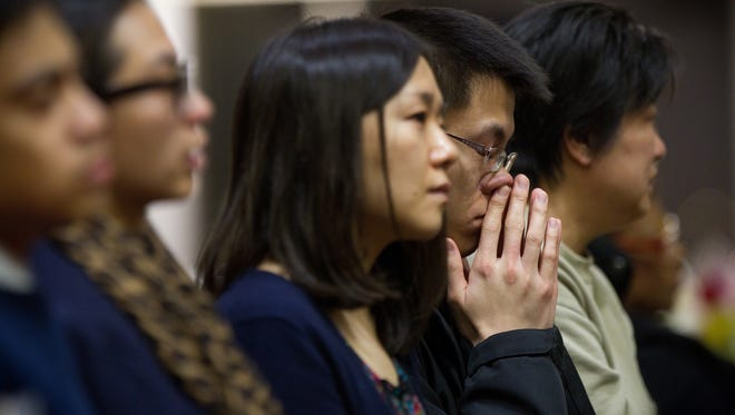 Friends, families and fellow students attend a memorial service for Boston University graduate student Lu Lingzi, who was killed in the Boston Marathon bombings, at Metcalf Hall at Boston University.