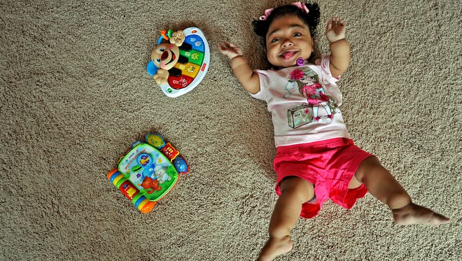 Janelly Martinez-Amador, 6, plays on the floor at her home in Nashville, Tenn., Wednesday, April 3, 2013. She was born with a metabolic disorder that kept her from forming bones.