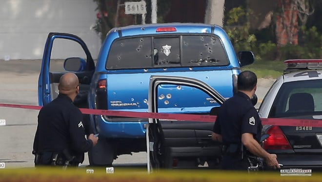 Los Angeles police officers hunting ex-cop Christopher Dorner fired at least 100 rounds into the Toyota Tacoma pickup driven by two women who were delivering newspapers about 5 a.m. Feb. 7 in in Torrance, Calif.