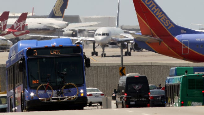 Jets taxi at Los Angeles International Airport on April 22, 2013, the second day of air-traffic control furloughs.
