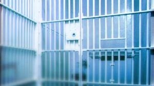 A federal grand jury indicted 13 female guards, seven inmates and five others with gang ties for alleged racketeering that involved smuggled drugs and cellphones and money laundering at Baltimore's main detention center and other jail facilities.