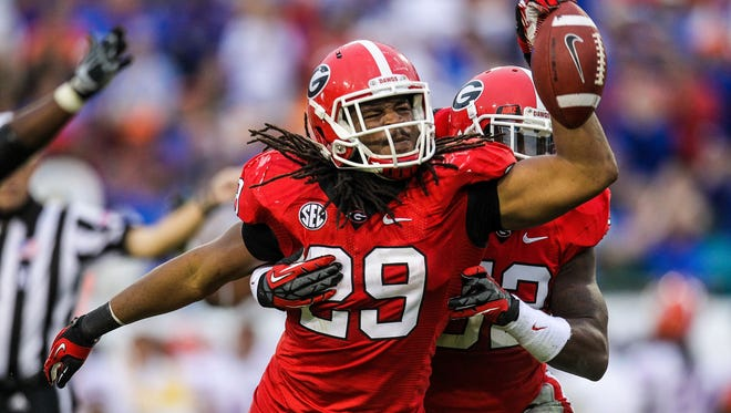 Georgia linebacker Jarvis Jones (29) celebrates after a fumble recovery in the second half against Florida at EverBank Field. The Bulldogs won 17-9.