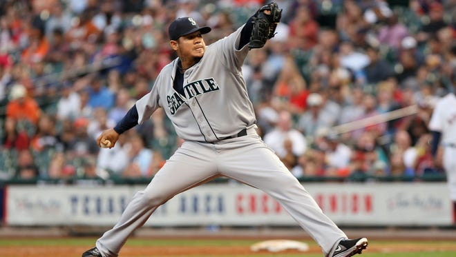 Seattle Mariners starting pitcher Felix Hernandez (34) pitches during the first inning against the Houston Astros at Minute Maid Park.