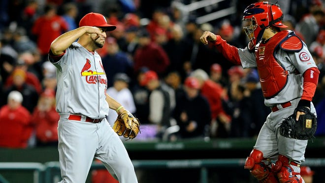 Edward Mujica earned his second save of the season Monday night, closing out the St. Louis Cardinals' 3-2 victory over the Washington Nationals.