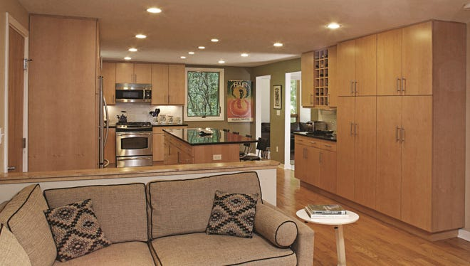 Hardwood floors, a kitchen island and granite counter tops give this home three popular features.