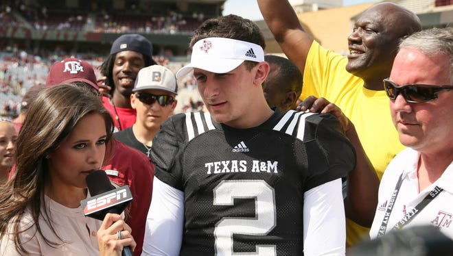 Texas A&M Aggies quarterback Johnny Manziel (2) is interviewed by ESPN announcer during the 2013 Maroon and White Texas A&M spring game at Kyle Field in College Station.