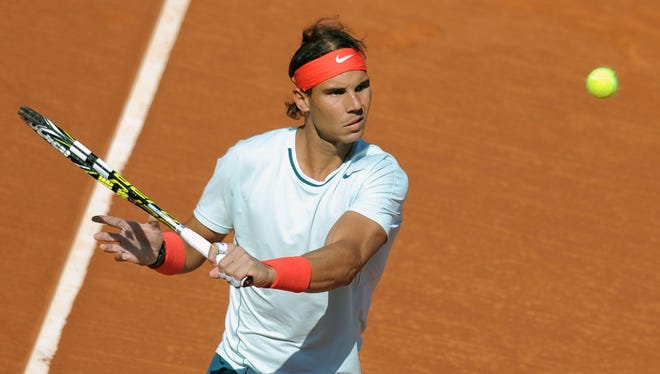 Rafael Nadal lines up a backhand during his 6-4, 6-2 victory Wednesday against Carlos Berlocq of Argentina.