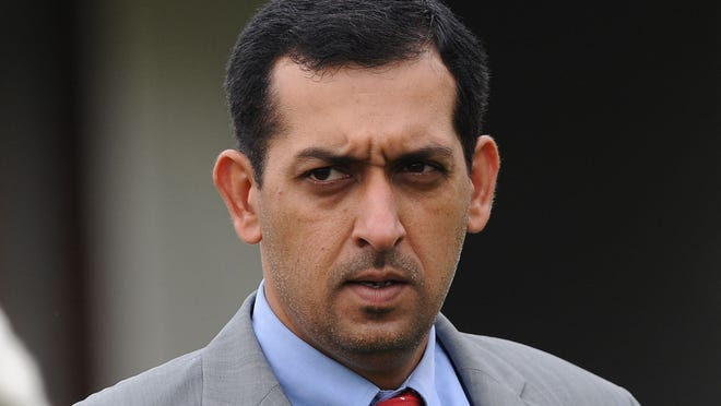 Trainer Mahmood Al Zarooni at Newmarket, England in 2012. Zarooni, a leading trainer from the powerful Godolphin stable, was charged Wednesday in connection with one of the biggest doping scandals to hit British horse racing.