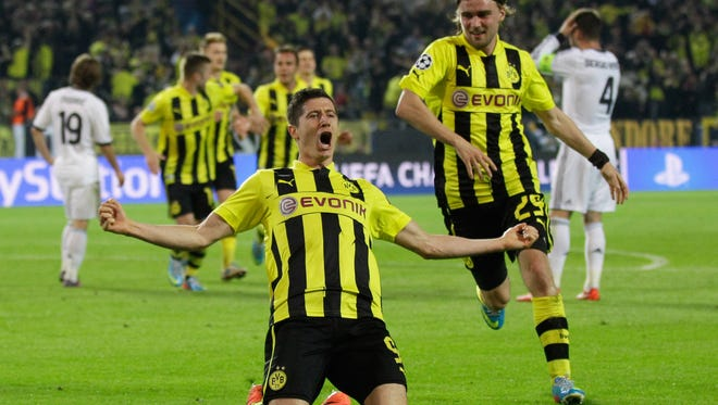 Dortmund's Robert Lewandowski, from Poland, celebrates after scoring his third goal during the Champions League semifinal first leg soccer match between Borussia Dortmund and Real Madrid in Dortmund, Germany, Wednesday.