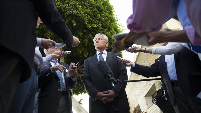 Secretary of Defense Chuck Hagel speaks with reporters Wednesday after meeting Egyptian President Mohammed Morsi and Egypt's defense minister in Cairo.