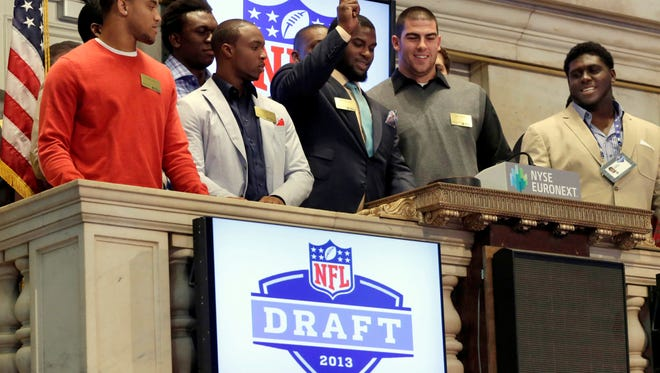 Top NFL draft prospects, including Sharrif Floyd of Florida, with the gavel, participate in closing bell ceremonies Wednesday at the New York Stock Exchange.