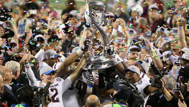 Texas A&M quarterback Johnny Manziel (2) celebrates with the Cotton Bowl trophy after a victory against Oklahoma on Jan. 4. The Cotton Bowl has returned to prominence with its addition to the College Football Playoff on Wednesday.