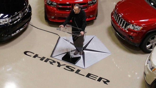 In this 2011 file photo, Fiat and Chrysler Group CEO Sergio Marchionne addresses the media.