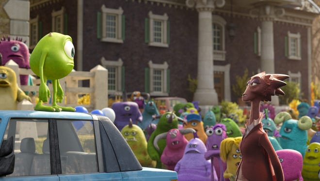 """Mike, on top of car, is voiced by Billy Crystal in """"Monsters University."""""""