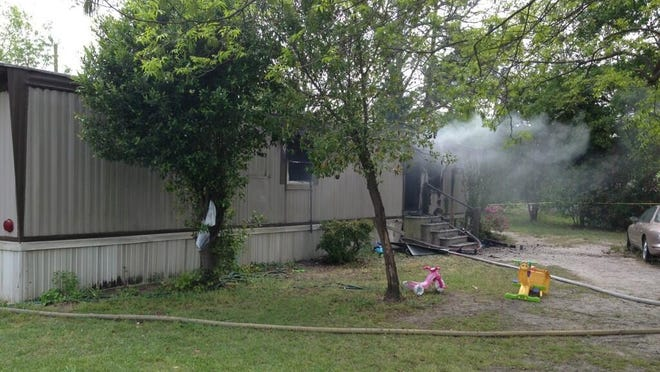 A fire swept through this mobile home in East Hartsville, S.C., April 24, 2013.