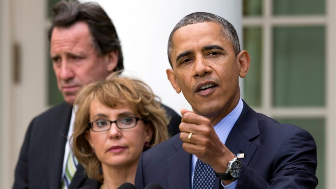 Former congresswoman Gabrielle Giffords stood with Neil Heslin, background, and President Obama in the Rose Garden after the Senate rejected a gun-control bill.