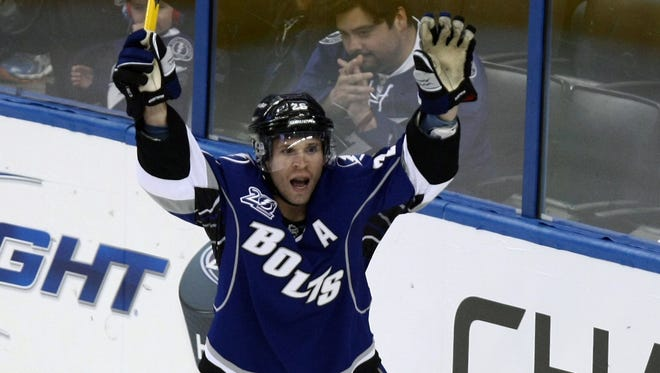 Tampa Bay Lightning right wing Martin St. Louis celebrates the second of his three goals Wednesday night.