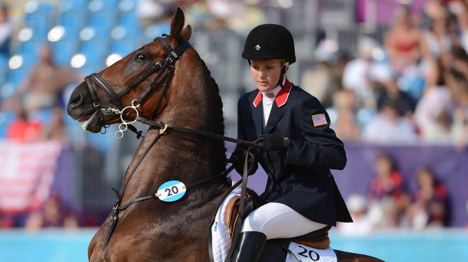 Margaux Isaksen calms Puck Glen (20) during the women's modern pentathlon show jumping during the London Olympics at Greenwich Park on Aug. 12.