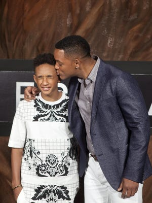 Will Smith kisses his son Jaden Smith as they pose for photos to promote their upcoming film 'After Earth' in Cancun, Mexico,  on Tuesday.