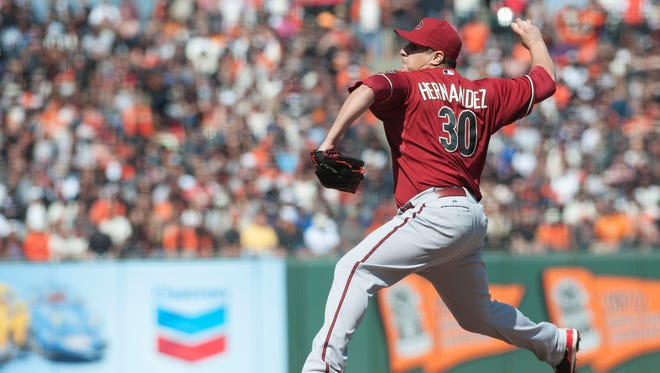 Arizona Diamondbacks relief pitcher David Hernandez pitches in relief against the San Francisco Giants during the tenth inning at AT&T Park.