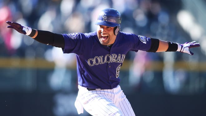 Rockies reserve Yorvit Torrealba celebrates after hitting a walk-off RBI single in the 12th inning.