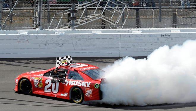 Matt Kenseth celebrates winning the STP 400 at Kansas Speedway.