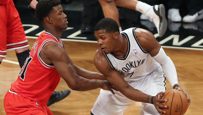 Nets guard Joe Johnson squares up against Bulls forward Jimmy Butler during Game 2 of their first-round playoff series.