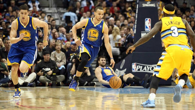 Klay Thompson and Stephen Curry led the Warriors to a Game 2 victory over the Nuggets.