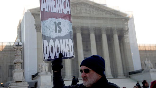 A member of the Westboro Baptist Church holds a sign in front of the Supreme Court on  March 27.