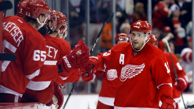 Detroit Red Wings center Pavel Datsyuk  is congratulated by teammates after scoring in the second period against the Los Angeles Kings.