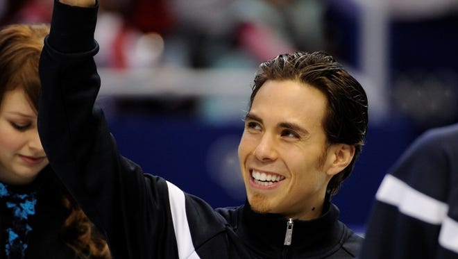 In a file photo from Feb. 26, 2010, Apolo Anton Ohno waves to the crowd after the 5,000-meter relay final.
