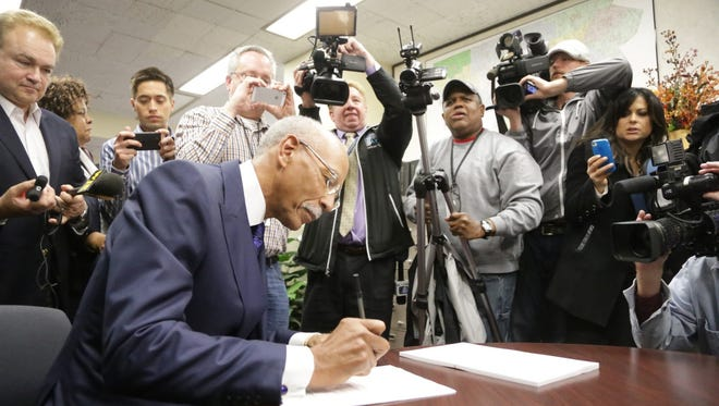 Detroit Mayor Dave Bing fills out paperwork Thursday in the City Clerk's Office at the Coleman A. Young Municipal Center in Detroit to seek re-election.