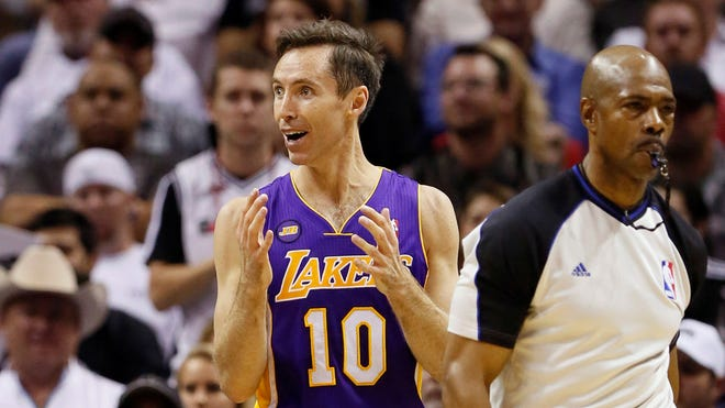 Los Angeles Lakers guard Steve Nash (10) reacts to a foul call during game two of the first round of the 2013 NBA Playoffs against the San Antonio Spurs at AT&T Center.