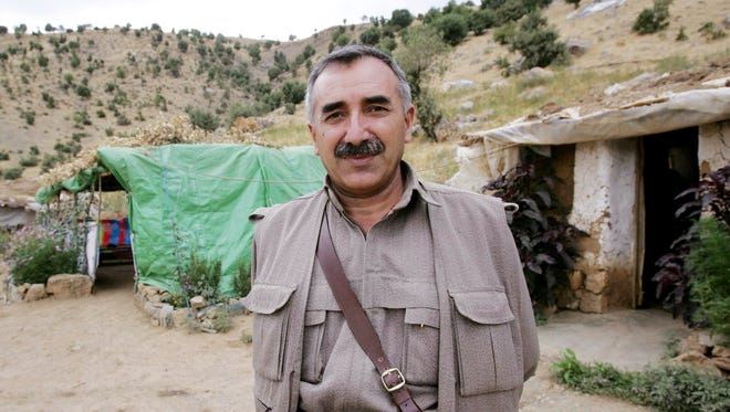 Murat Karayilan poses during an interview at a camp near Arbil in the Sinena mountains, northern Iraq, in 2005.